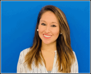 Image of Lizzett Uria, one of PEATC's family support specialists. She is smiling and standing in front of a blue background. She has long brown hair with light-brown highlights, and is wearing a white sweater.