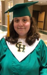Logan Getting Ready for Graduation wearing her cap and gown
