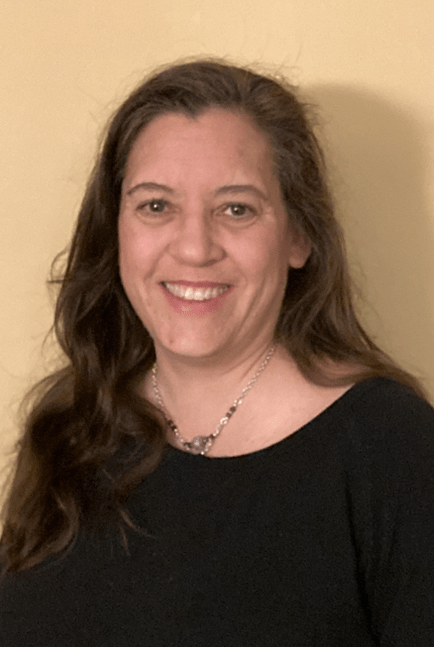 Image of Cindy Brown, one of PEATC's family support specialists. She is smiling, has long, wavy brown hair, has brown eyes, and is wearing a black shirt.